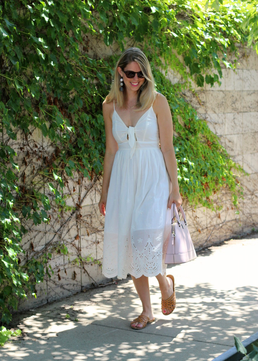 Summer white dress in the city